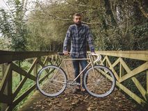 Hipster man with his fixie bike Stock Images
