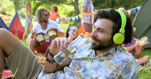Hipster man listening music and drinking stock video footage