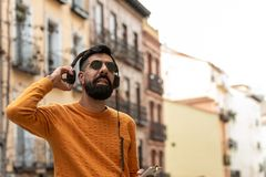 Hipster Man Listening Music on Headphones stock images