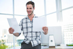 Hipster man looking at document Royalty Free Stock Photography