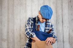 Hipster man looking for something in his bag Royalty Free Stock Photos