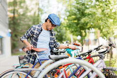 Hipster man parking fixed gear bike on city street Royalty Free Stock Images