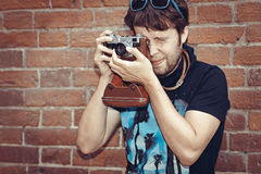 Hipster man photographer with camera Royalty Free Stock Photo
