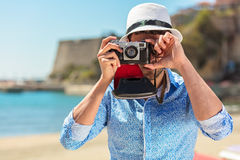 Hipster man photographer taking photo with retro camera Royalty Free Stock Photography