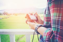 Hipster man photography using retro camera with nature on the b Stock Photography