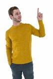 Hipster man pointing upward Royalty Free Stock Image