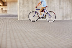 Hipster man riding fixed gear bike Royalty Free Stock Image
