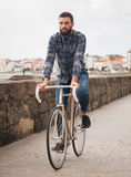 Hipster man riding in  a fixie bike Stock Photography