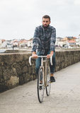 Hipster man riding in a fixie bike Stock Images