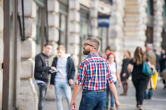Hipster man shopping in streets of London, back view Stock Photo