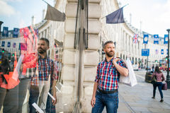 Hipster man shopping in the streets of London Stock Photos