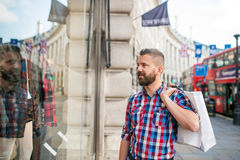 Hipster man shopping in the streets of London Royalty Free Stock Photo