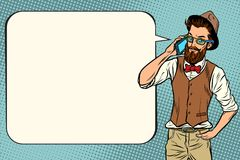 Hipster man with a smartphone Royalty Free Stock Image