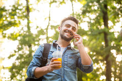 Hipster man speaking over mobile phone Stock Images