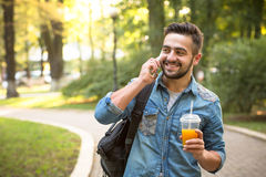 Hipster man speaking over mobile phone Royalty Free Stock Images