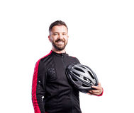 Hipster man in sports sweatshirt holding helmet, studio shot Royalty Free Stock Photos