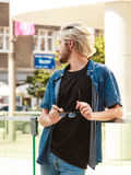 Hipster man standing on city street, urban fashion Stock Photography