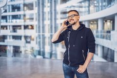 Hipster man talking on the mobile phone stock photo