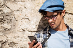 Hipster man texting message on smartphone. Leisure, technology, communication and people concept - close up of hipster man texting message on smartphone royalty free stock image