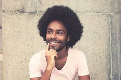 Dreaming and thinking african american hipster man. Outdoors in vintage retro look royalty free stock photography