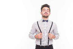 Hipster man touching his braces in studio Royalty Free Stock Photos