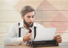 Hipster man  on typewriter with wood Royalty Free Stock Images