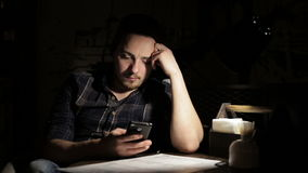 Hipster man using smartphone in cafe in the night. Young man using smartphone in cafe in the evening stock video