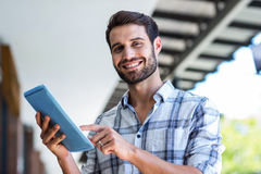 Hipster man using tablet computer in the city Stock Image