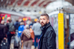 Hipster man waiting at the crowded train station Royalty Free Stock Photo