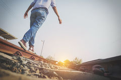 Hipster man walk on the railway tracks to finding target of life Royalty Free Stock Photography