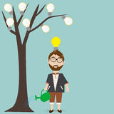 The Hipster man water the plant of ideas Royalty Free Stock Photography