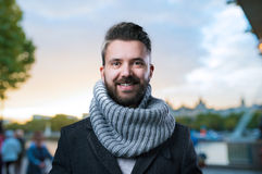 Hipster man in winter clothes in the city Royalty Free Stock Photo