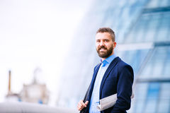 Hipster manager in blue shirt, London City Hall Royalty Free Stock Images