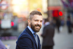 Hipster manager in the crowded street of London, Piccadilly Circus Stock Image