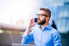 Hipster manager with smart phone, London City Hall Royalty Free Stock Image