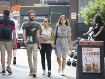 Hipster Men And Woman Dressed In Cool Londoner Style Walking In Brick Lane, A Street Popular Among Young Trendy People Royalty Free Stock Photography