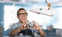 Photography as a hobby. Hipster men in glasses with old photo camera Royalty Free Stock Photos