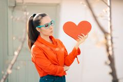 Young Girl Wearing Eyeglasses Holding Big Heart stock photography