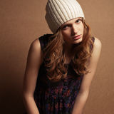 Hipster model with curly red hair and beige hat Stock Photos