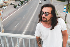 Hipster model with long hair Stock Photography