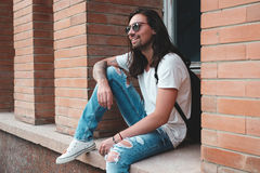 Hipster model with long hair Royalty Free Stock Photo