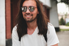 Hipster model with long hair Stock Photo