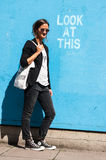 Hipster model wearing sunglasses posing next to Lo stock photos