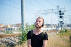 Hipster modern stylish blonde man listening music Stock Image