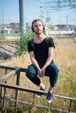Hipster modern stylish blonde man listening music Stock Photography