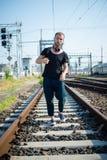Hipster modern stylish blonde man on rails Royalty Free Stock Photography