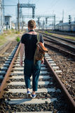 Hipster modern stylish blonde man on rails. In daily life Stock Image