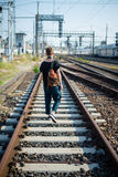 Hipster modern stylish blonde man on rails Royalty Free Stock Images