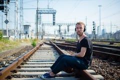 Hipster modern stylish blonde man on rails Stock Image