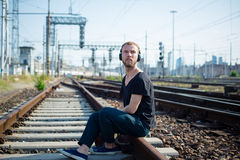 Hipster modern stylish blonde man on rails Stock Image